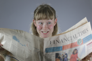 Girl reading financial times