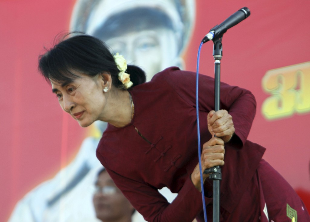 Aung San Suu Kyi speaks to supporters during a ceremony
