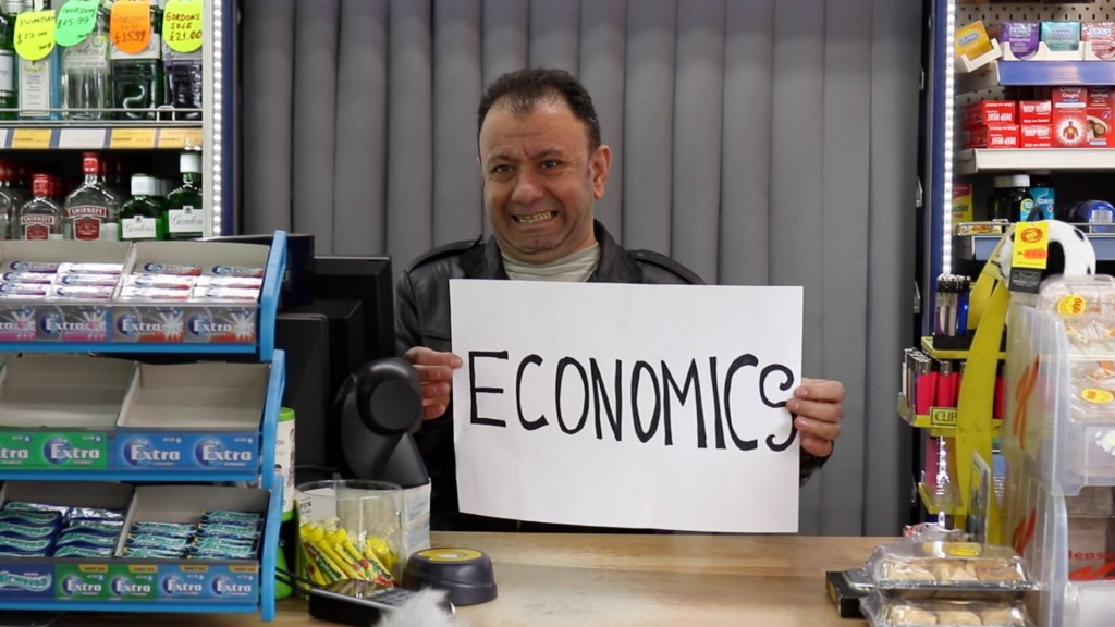 Man holding economics sign.