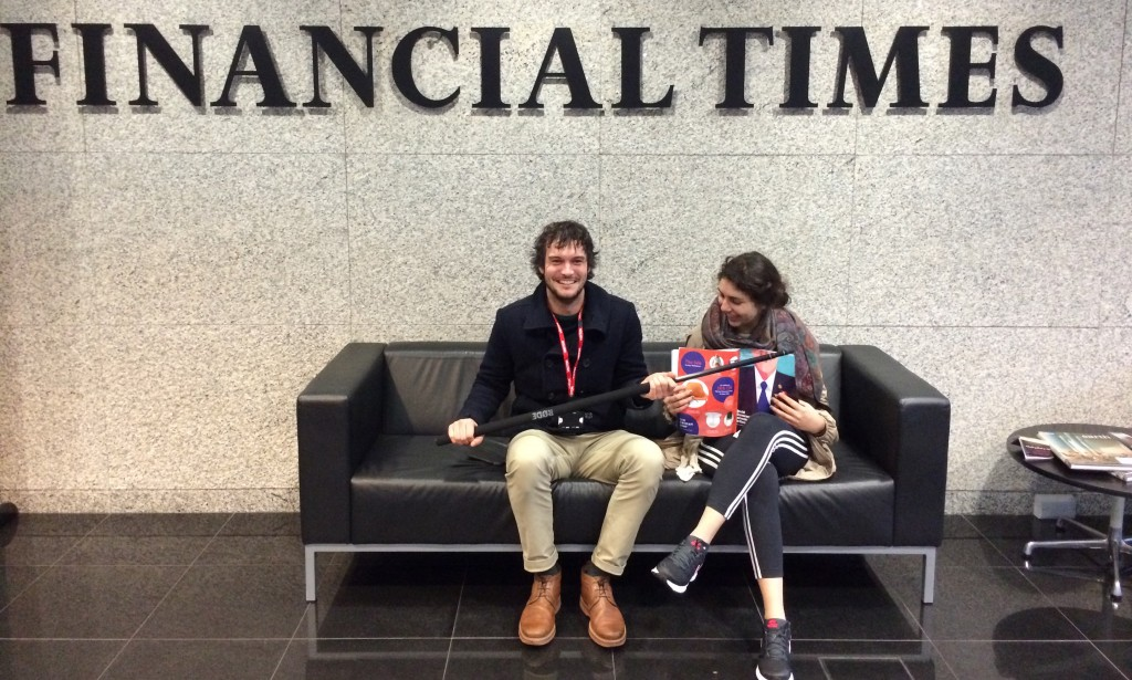 Two members of the Economy team wait in the reception area of the Financial Times