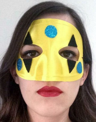 A woman wearing a My Chemical Romance Harlequin mask