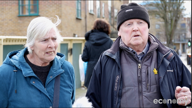 A screen grab of an older couple in East London talking to camera