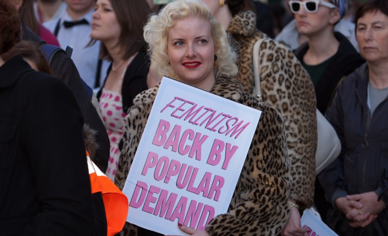 Campaigner holds a placard reading