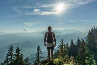 A backpacker looks over mountains