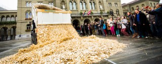 Swiss basic income advocates dump 8 million coins in a public square to celebrate the 125,000 signatures that forced the government to hold a referendum on the proposal in 2016.