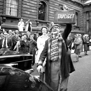 Ernest Stokes holds aloft a case with the word 'budget' written on it on budget day 1966 in London