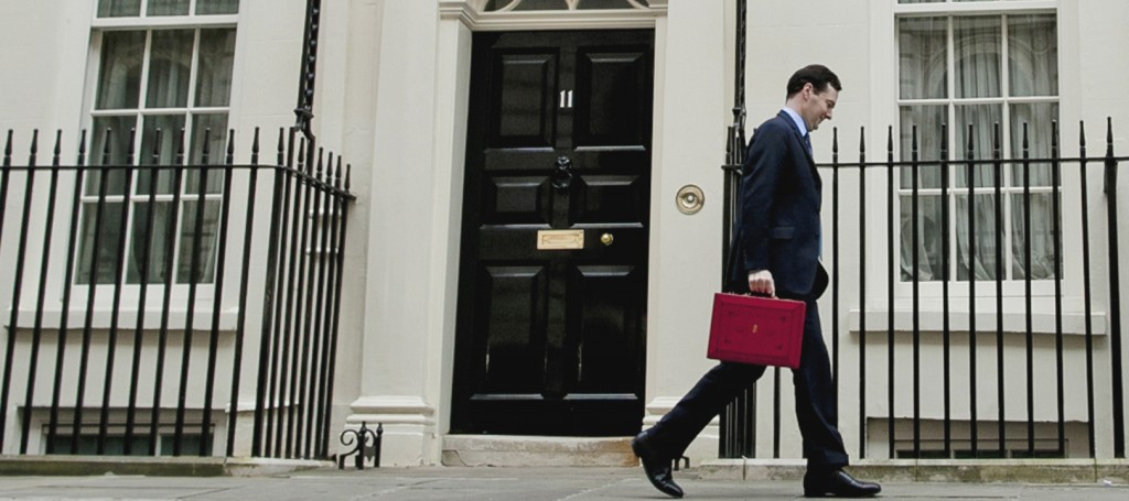 Chancellor of the Exchequer George Osborne leaves his official residence No 11 Downing Street in London with his traditional red dispatch box as he departs for the House of Commons to deliver his annual budget speech