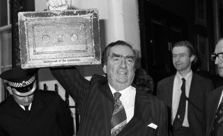 Former Chancellor Denis Healey holds up his despatch box as he leaves 11 Downing Street to present his budget in the House of Commons in 1977.