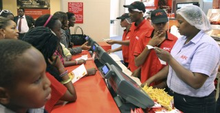 Customers waiting to place their orders at Kentucky fried chicken restaurant in Nairobi, Kenya