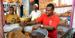 Three Somalis in prepare food in Mogadishu