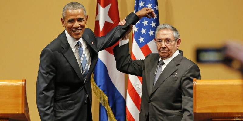 Cuban President Raul Castro lifts U.S. President Barack Obama's arm after delivering speeches at the Palacio de la Revolucion in Havana, Cuba, on Monday, March 21, 2016