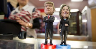 Wobbling figures with the heads of Republican candidate Donald Trump and Democrat candidate Hillary Clinton