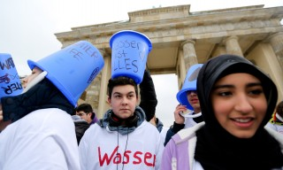 Students demonstrate against polluted water on World Water Day 2013 in front of the Brandenburger Tor in Berlin