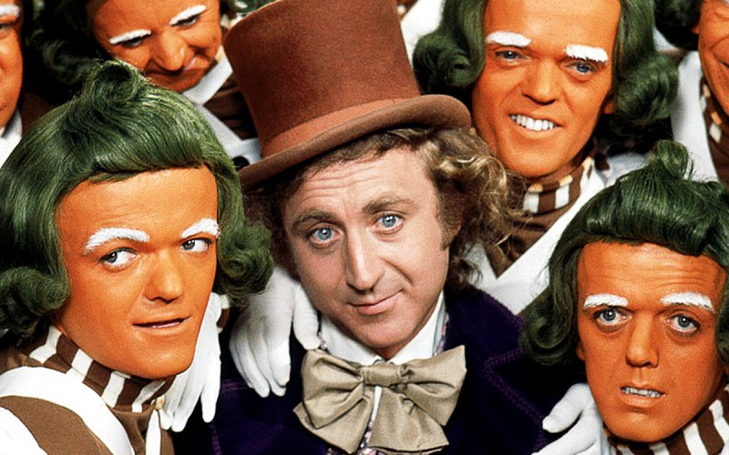 Willy Wonka (Gebe Wilder) poses with the Oompa Loompas
