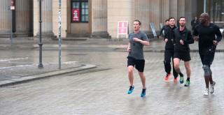 Facebook founder Mark Zuckerberg runs with bodyguards in Berlin,Germany