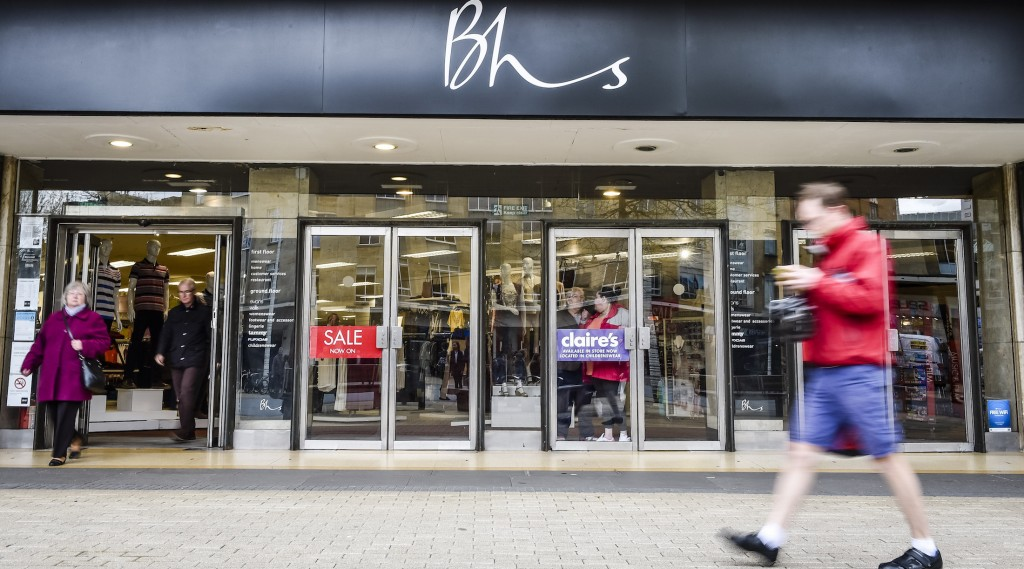 A person walks past a BHS store in Bristol, UK