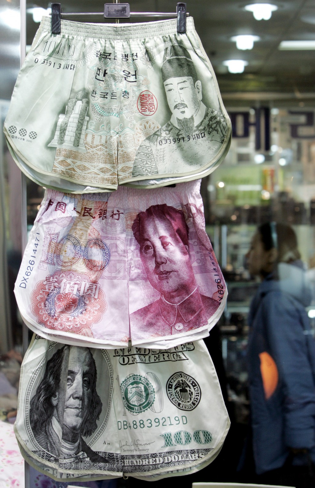 Men's underwear with banknote prints of South Korea won, Chinese yuan and U.S. dollar are displayed at a shop in Seoul