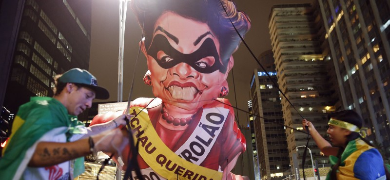 Protesters in Brazil inflate a giant effigy of former president Dilma Rousseff