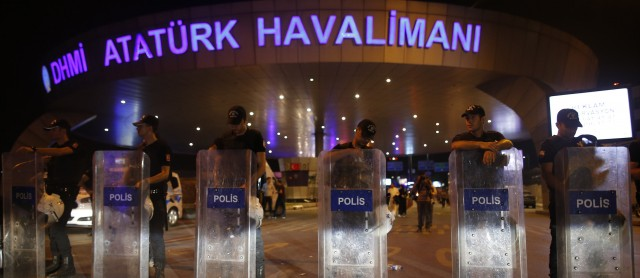 A line of police stand in front of Ataturk Airport in Turkey
