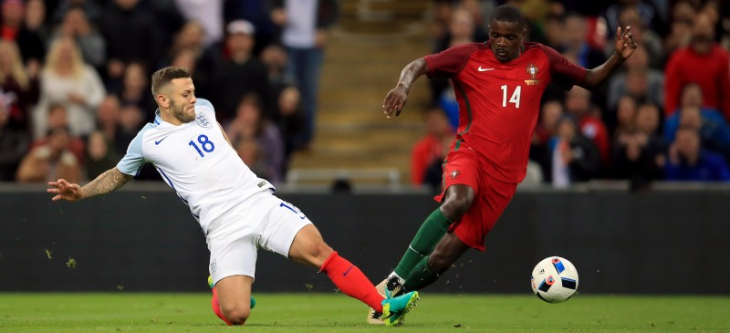 England's Jack Wilshere (left) and Portugal's William Carvalho battle for the ball