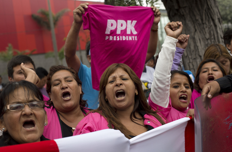 Voters in Peru hold a PPK T-shirt aloft
