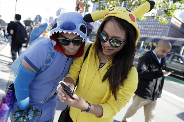 People costumed as the game's characters participate in a Pokemon Go search