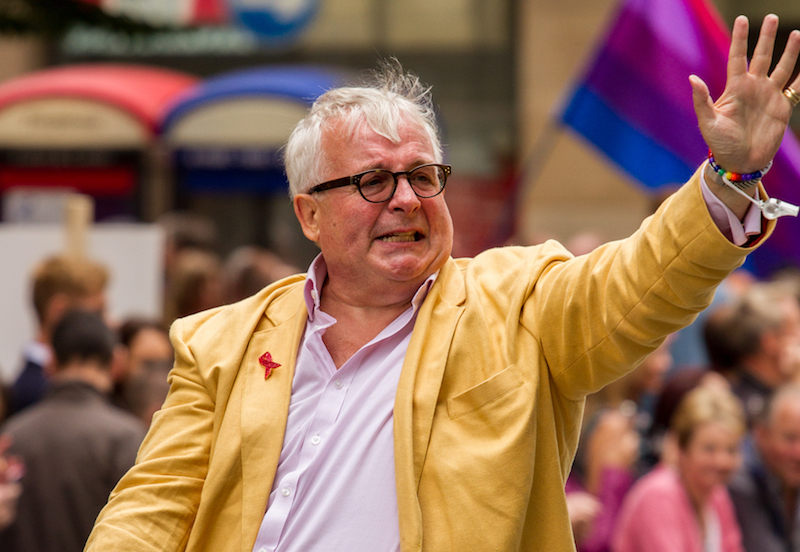 Christopher Biggins waves to crowds at Manchester Pride