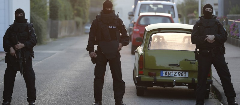Special police officers secure a street near the house where a Syrian man lived before the explosion in Ansbach, southern Germany on July 25, 2016.