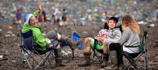 Festival goers in the aftermath of Glastonbury Festival, at Worthy Farm in Somerset.