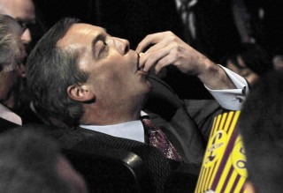 Nigel Farage eating popcorn