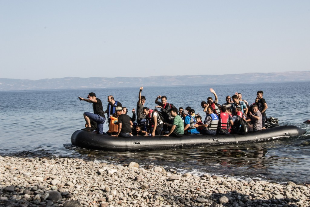 Refugees arrive on a boat in Lesbos, Greece.
