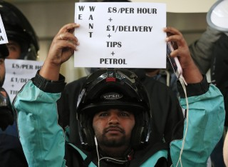 Deliveroo riders make wage demands during a protest outside the company offices in Torrington Place, Fitzrovia, London.