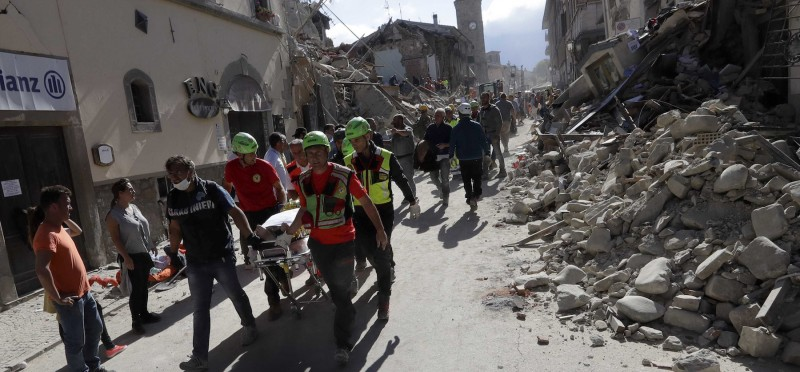 Rescuers on the site of the earthquake in central Italy