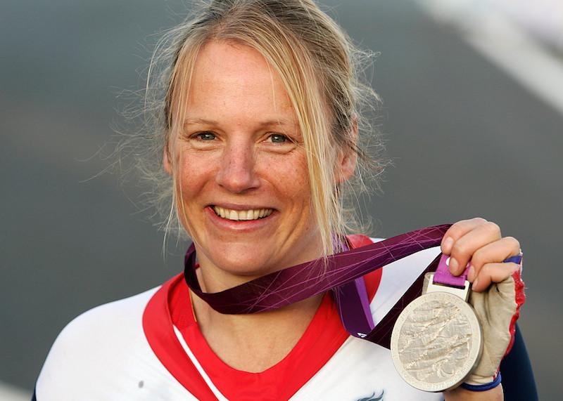 Karen Darke holds her Paralympic silver medal