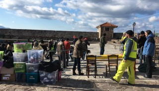 Volunteers organize supplies in the harbour in Lesvos