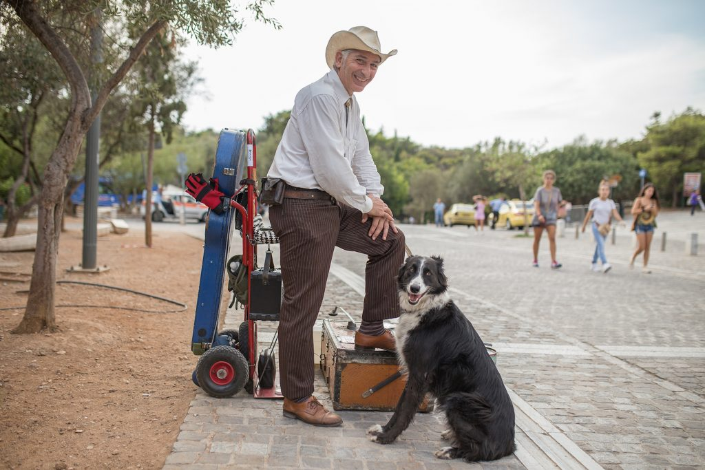 A street musician and his dog in Greece.