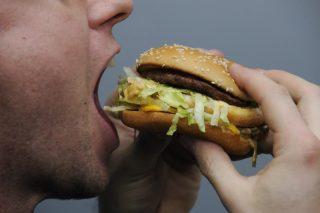 A man eating a Big Mac