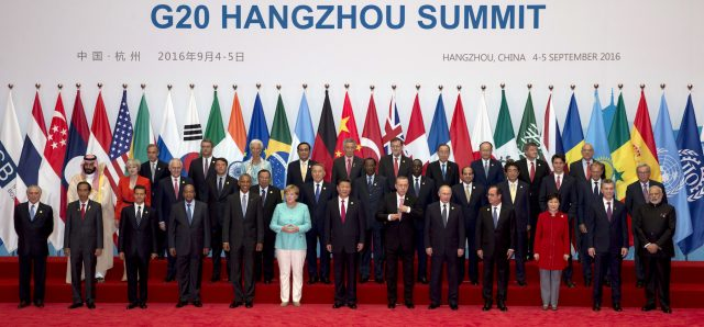 State leaders take part in a group photo session for the G20 Summit in China