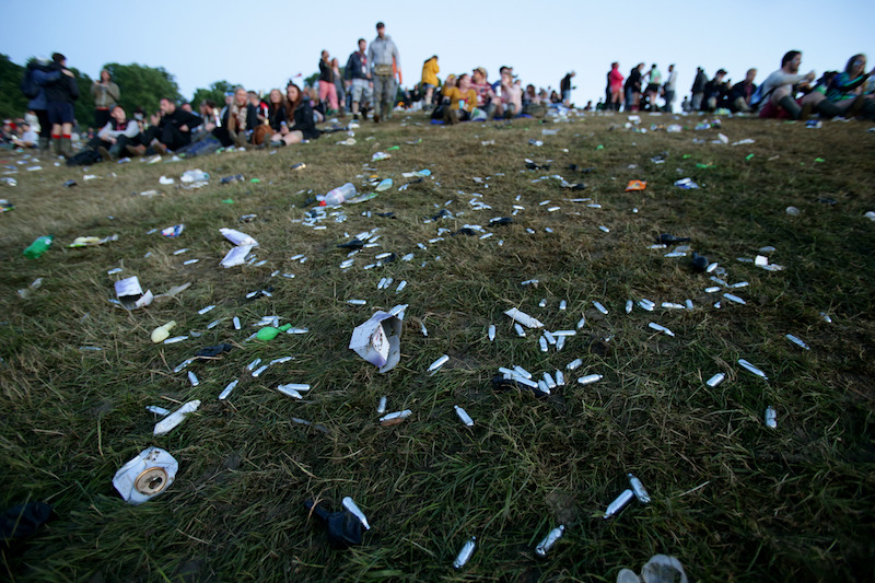 Discarded nitrus oxide capsules litter the ground at Glastonbury