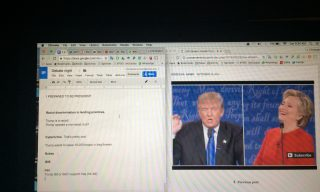 A computer screen showing the live stream of US presidential debate