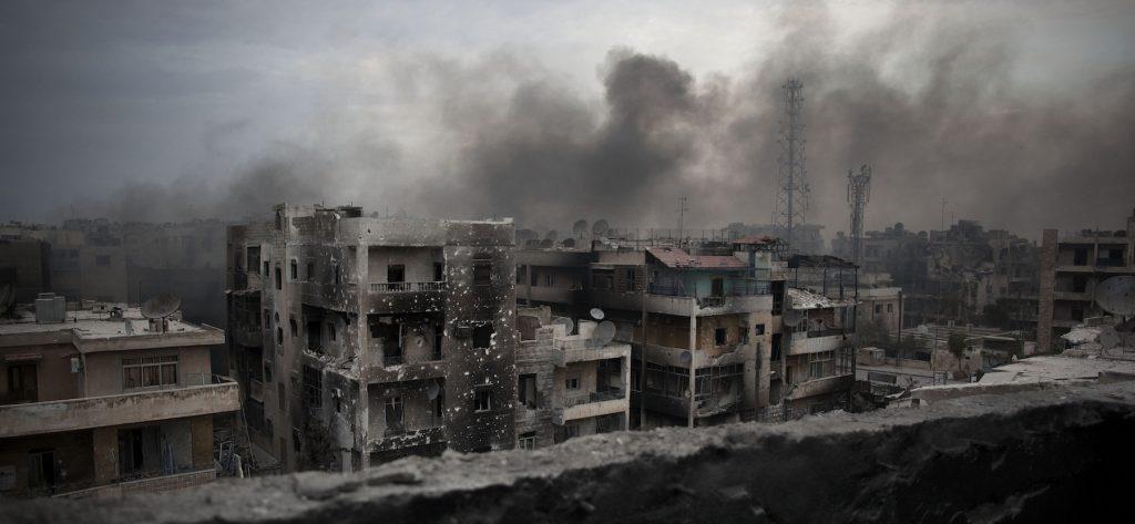 Smoke rises over Saif Al Dawla district, in Aleppo, Syria.