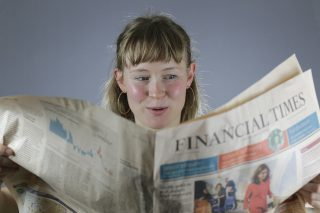 Girl reads Financial Times