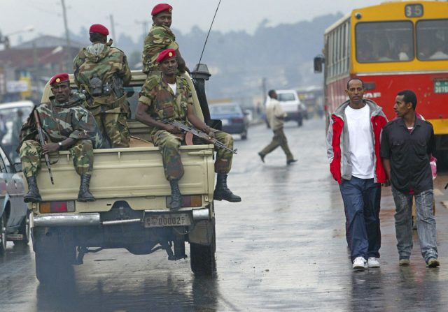 An army tank patrols an Ethiopian city during the state of emergency.
