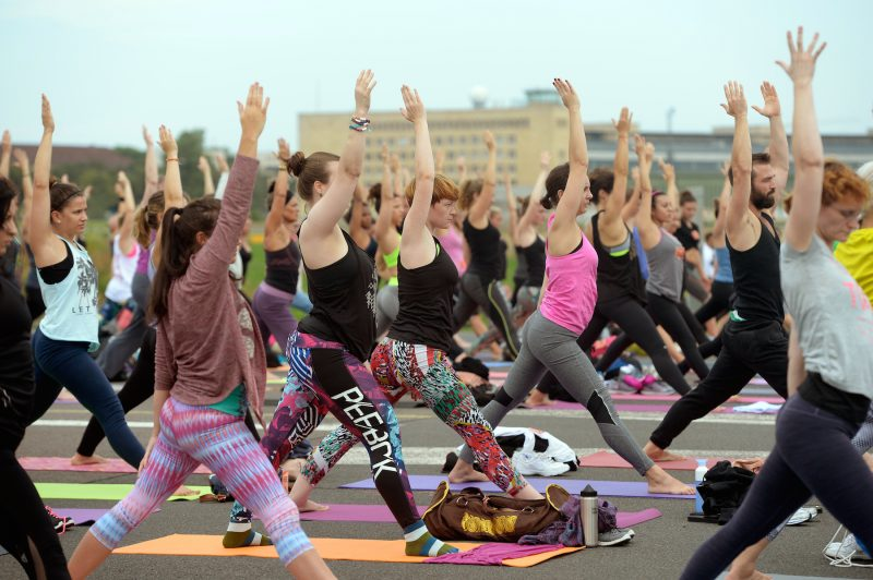 A yoga class takes places in Tempelhof, Berlin.