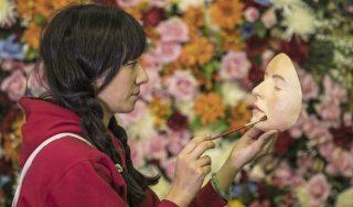 Natasha paints a model face