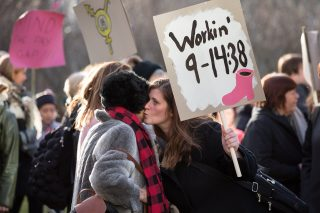Icelandic protester with sign reading
