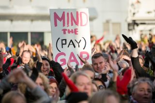 Protester with sign reading