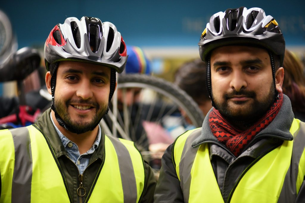 Two men wearing bike gear