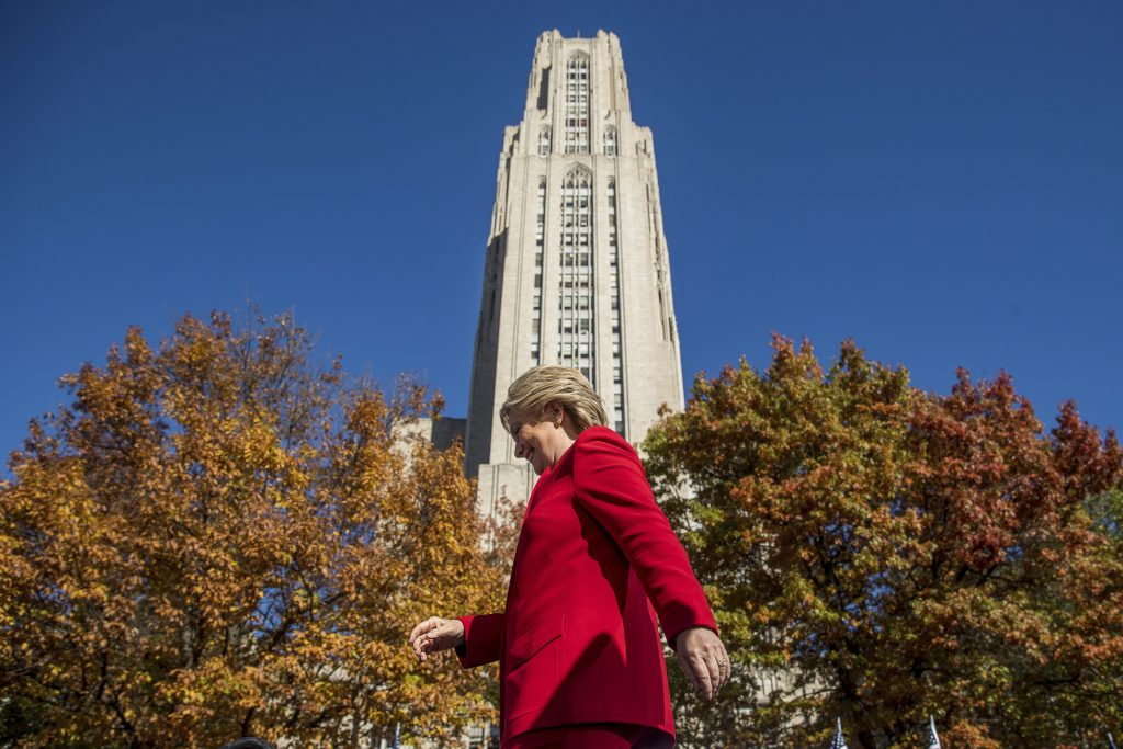 Hillary Clinton walking in front of the citadel of learning in Pittsburgh