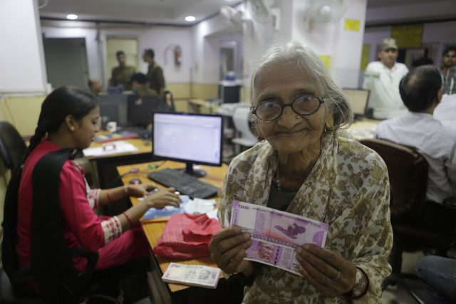 Indian woman holding new money